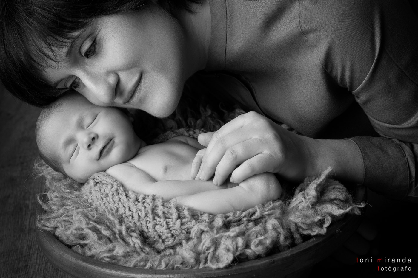 Mother with her newborn baby girl in black and white photoshoot